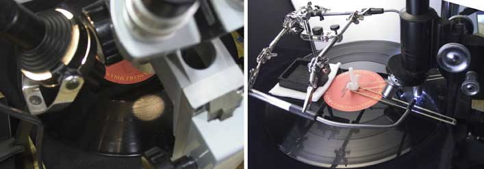 Two microscopes used to examine record surfaces