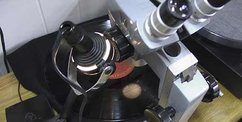 LP Record album under microscope